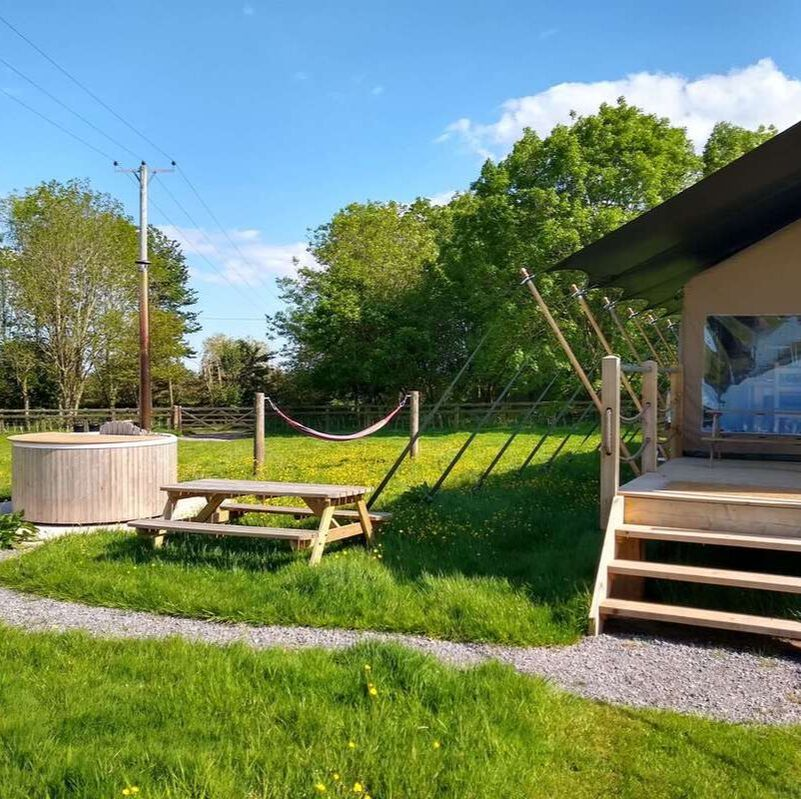 Porlock safari tent with hot tub and trees