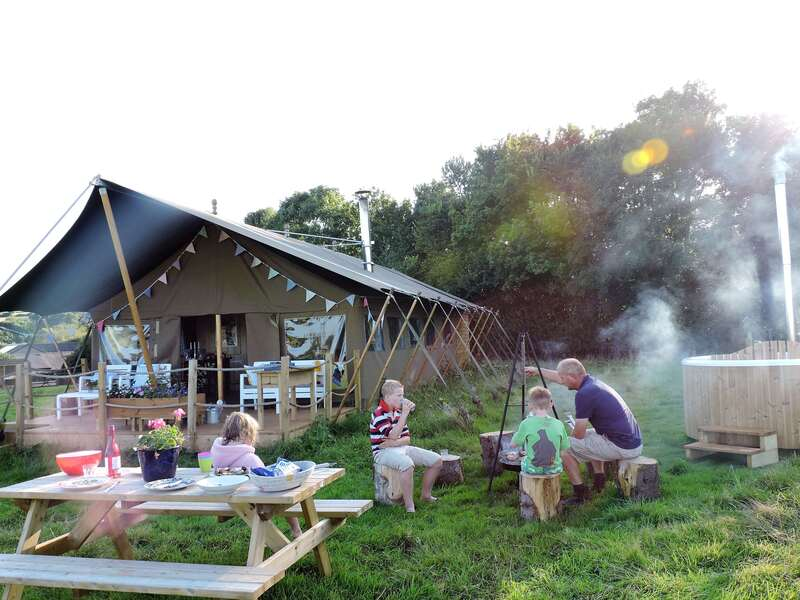 Family Glamping with hot tubs in safari tents on an organic farm in Somerset