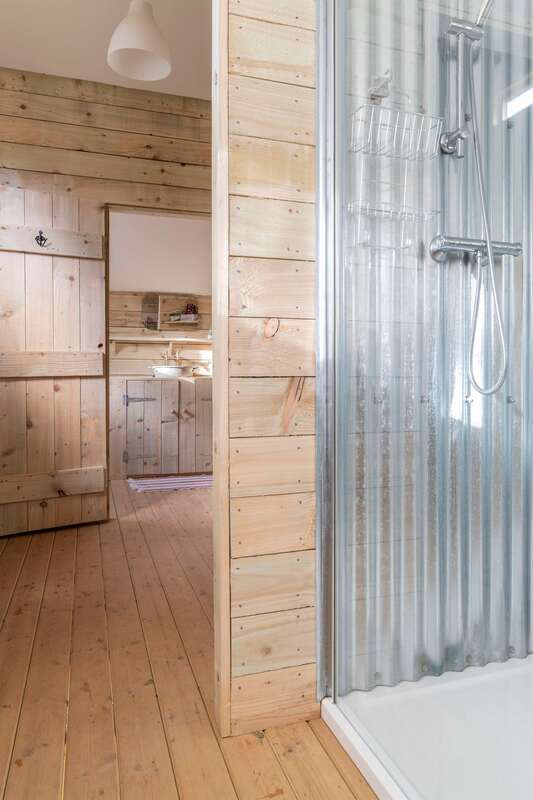 Private ensuite glamping bathroom with hot shower and flushing toilet at Middle Stone Farm, Somerset