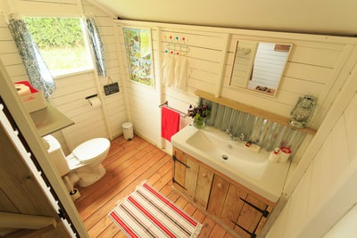 Glamping safari tents with private ensuite bathrooms and flushing toilets.