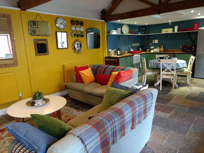 Holiday cottage on working farm.  The Stable cottage has a hot tub and sleeps 4 guests.